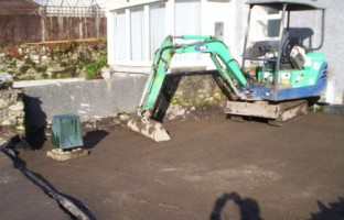 LIGHT WORK: Hiring a mini-digger with driver is a cost-effective way of clearing large amounts of ground and ensuring you have the basis for good foundations